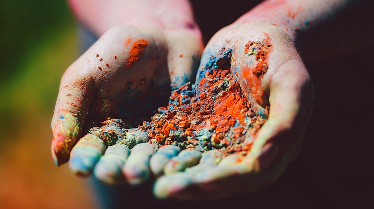 Dirty woman's hands with colorful powder